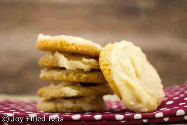 Iced Vanilla Almond Flour Cookies stacked up on a napkin