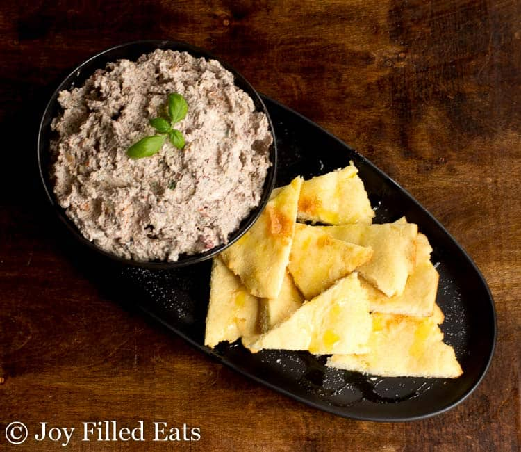 A black serving tray of Mediterranean Cheese Spread Recipe with Fathead Pita Dippers