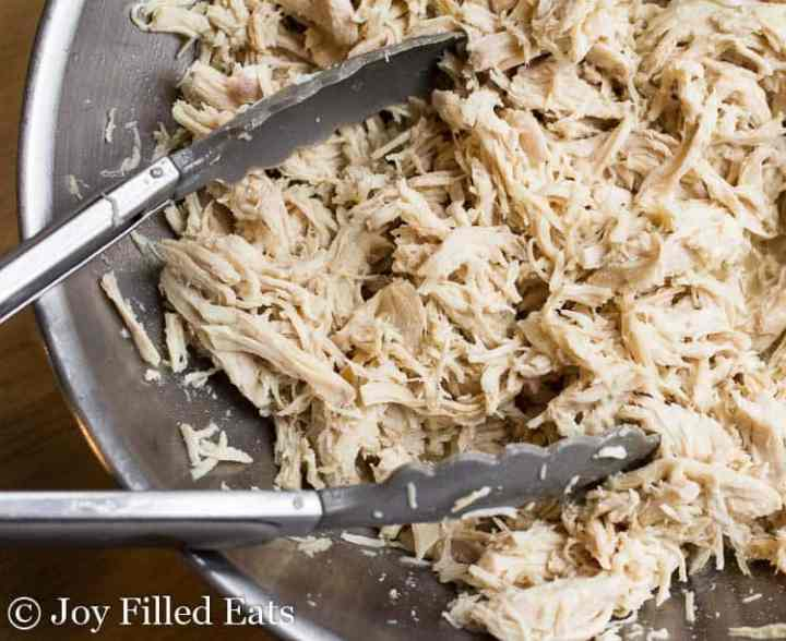A big bowl of shredded chicken