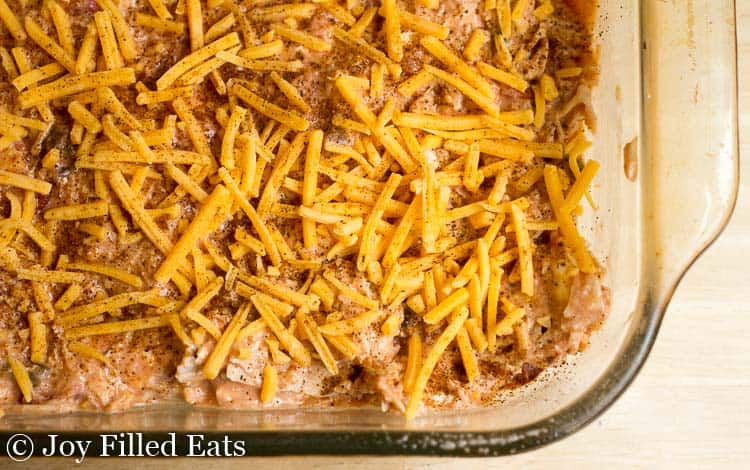 The unbaked casserole topped with cheese