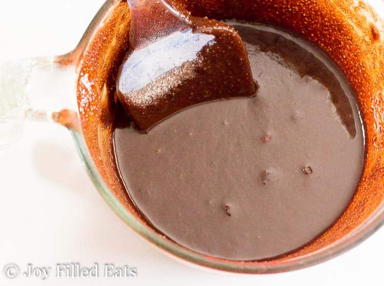 a glass bowl of melted chocolate