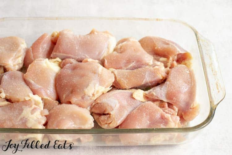 chicken thighs in a 9 x 13 glass baking dish