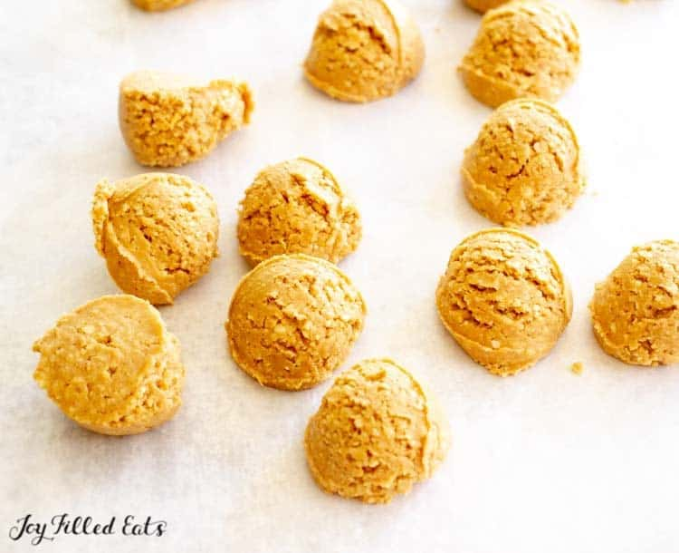 scoops of peanut butter ball filling on wax paper