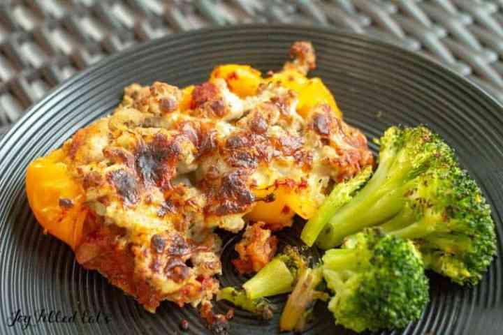 stuffed pepper casserole and broccoli on a black plate