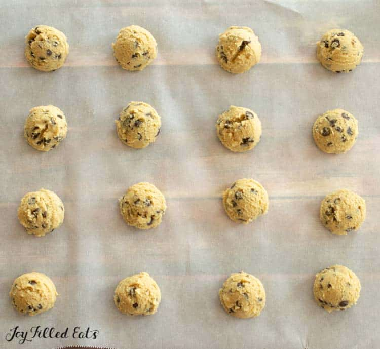 balls of eggless cookie dough on parchment paper