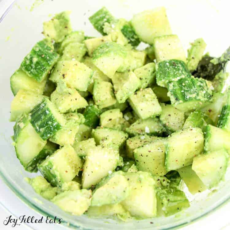 the cucumber avocado salad in a glass bowl