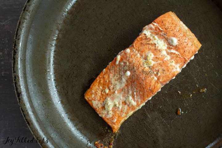cooked salmon filet in a large skillet