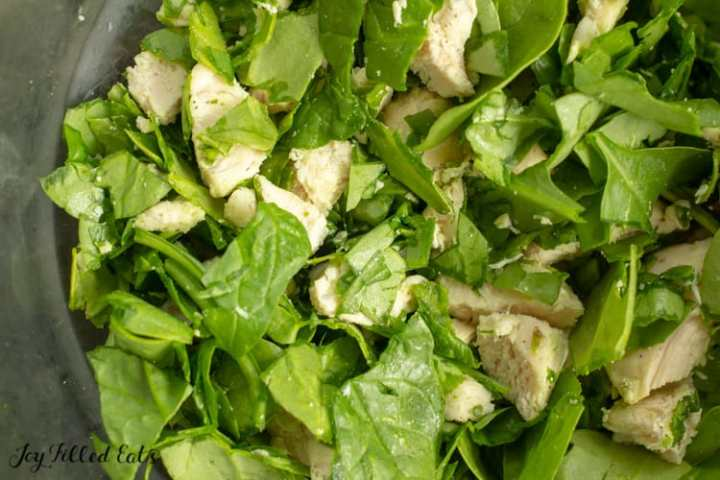 chopped spinach and chicken in a large bowl