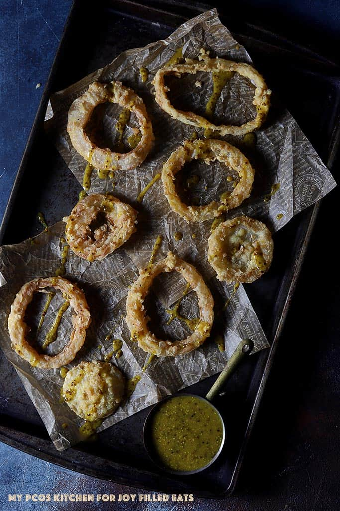 low carb onion rings with honey mustard sauce on a baking tray