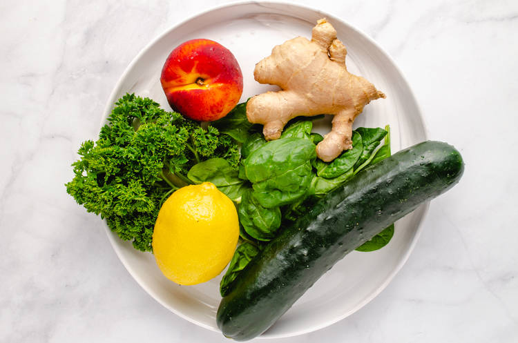 green smoothie ingredients on a white plate