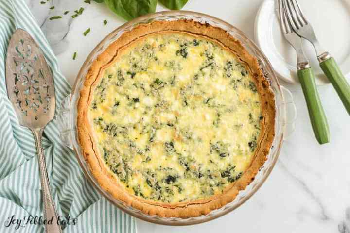 the baked spinach and feta quiche in a glass pie plate
