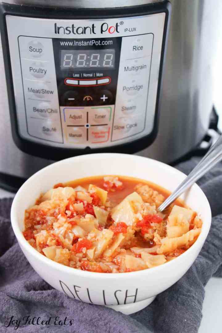 an instant pot and a bowl of cabbage roll soup
