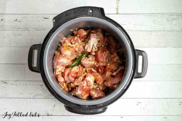 the instant pot with pork and seasonings