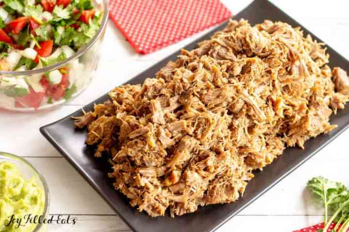 pile of shredded pork instant pot carnitas on a platter