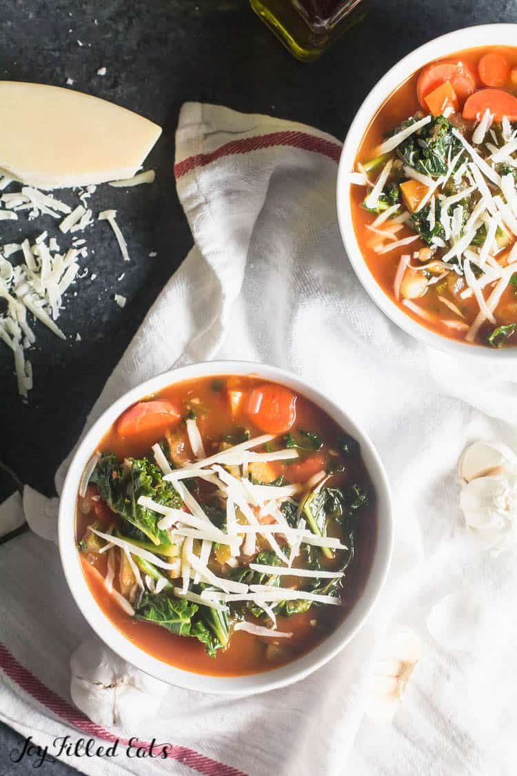 two bowls of easy vegetable soup topped with cheese