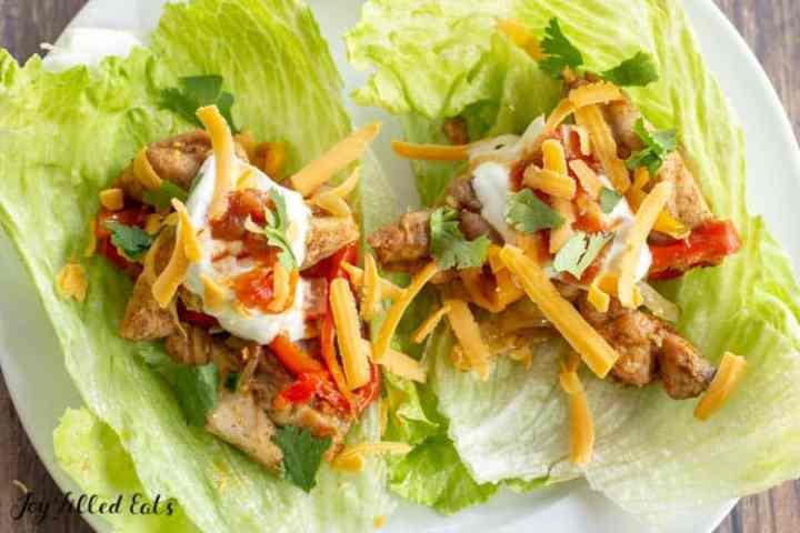 baked chicken fajitas lettuce wraps on a plate