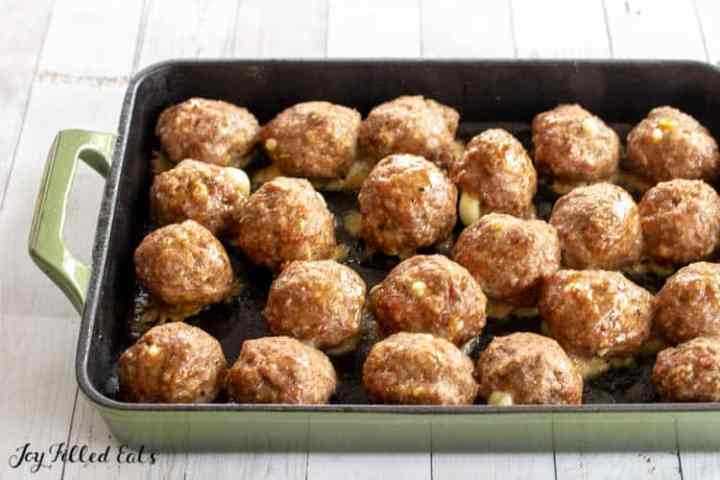 cooked low carb meatballs in a roasting pan