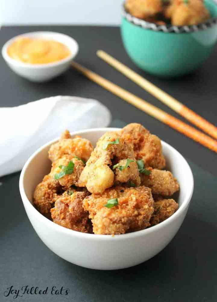 keto bang bang cauliflower with bang bang sauce in a small bowl