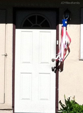 God Bless America windsock at rectory
