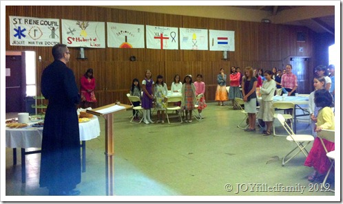 9.1.12 Fr. Stinson talking to the girls about hospitality and blessing