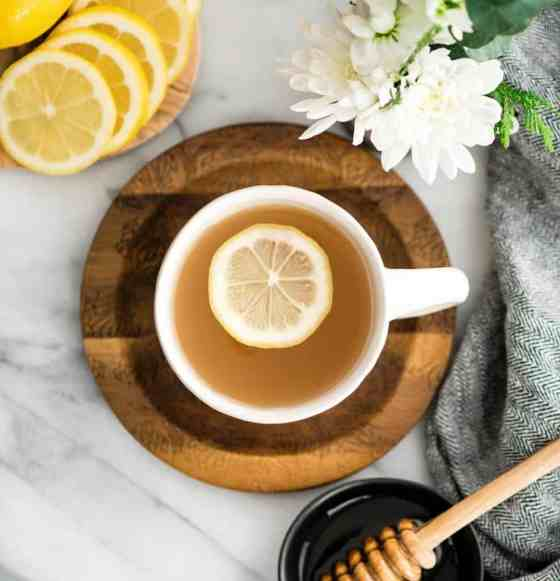 Overhead view of Immune Boosting Tea Recipe in a mug with a lemon slice in it