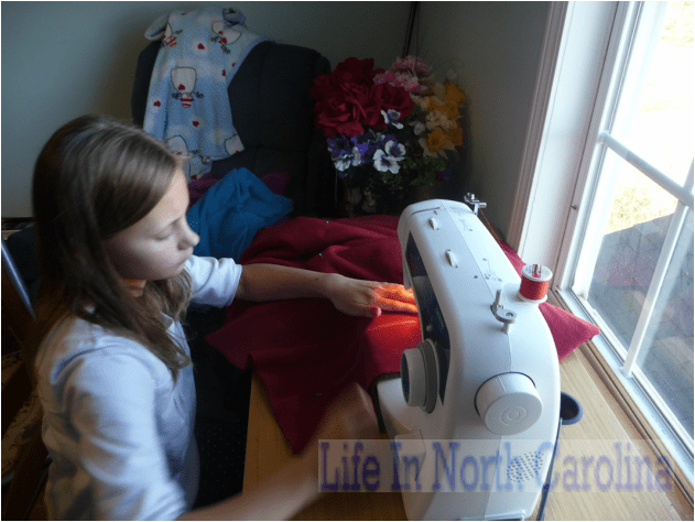 Creating a fleece blanket with granchildren.  They are a blessing!