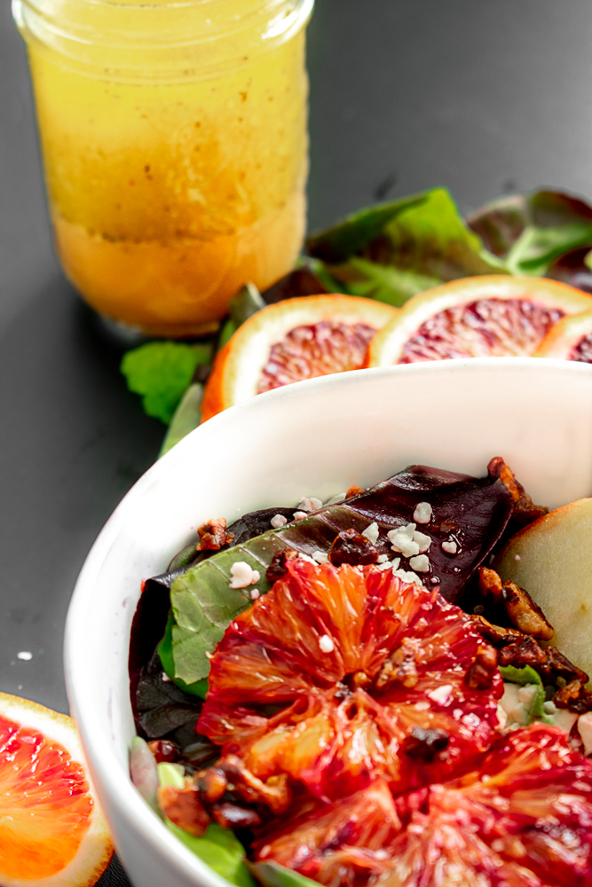 Blood orange salad in a white bowl