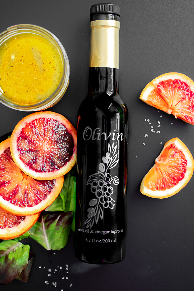 Blood orange fused olive oil next to blood orange slices