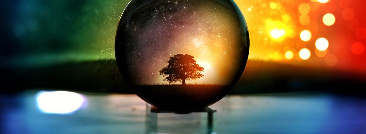 Close up of a globe with a tree silhouette within for Joyful Empath. We offer LGBTQ therapy in San Francisco, CA, transgender therapy in Berkeley, CA, and more. Contact us today to get in touch with a gender affirming therapist today.
