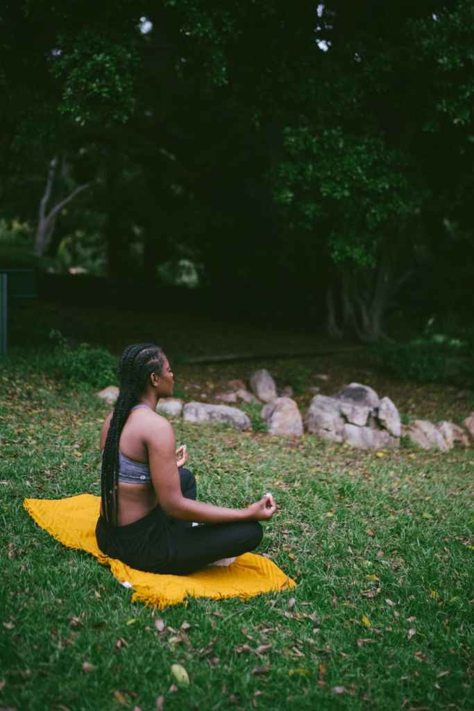 African american woman meditates in the grass. She has been looking for spiritual guidance in East Bay. Joyful Empath offers a soul sanctuary in Berkeley, CA. Contact an hsp therapist for support, intuitive therapy, and more. You can get LGBTQ therapy in Berkeley, CA with Phoenix as well. Learn about the Soul Sanctuary in San Francisco, CA here!