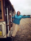 Keira Andrews riding a cable car