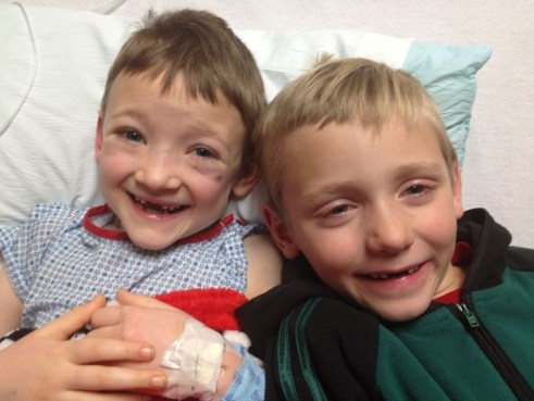 Two cousins with matching two front teeth missing!
