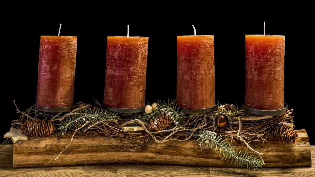 four brown wax candles