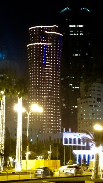 The Qatar International Islamic Bank Tower changing colors.........