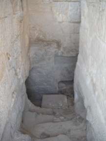 Looking down into one of the rock cut tombs