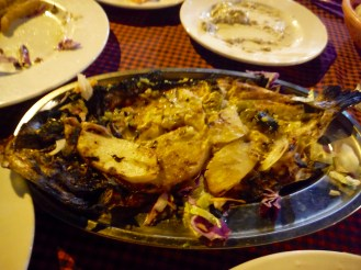 Fish - cooked Egyptian way - opened, filleted, baked in an open oven with potatoes and garlic and onions!!