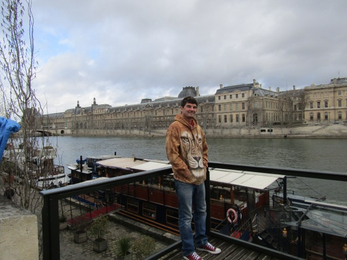 Walking onto Quai Malaquais along the Seine and there is the Louvre!