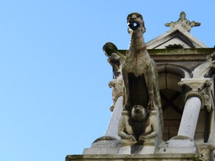 A gargoyle on one of the flying buttresses spitting water after a sudden rain fall!!!