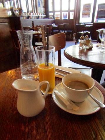 Fresh orange juice and coffee with hot milk!
