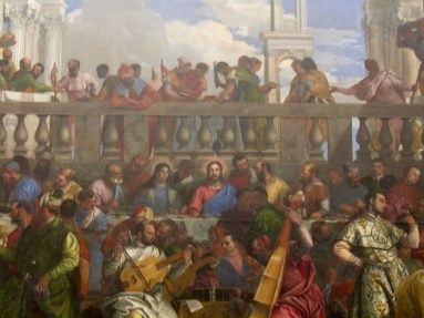 Paolo Caliari, known as Paolo Veronese - The Wedding at Cana - 1563. Jesus has that look on his face because at that moment he is performing the miracle of turning water into wine!