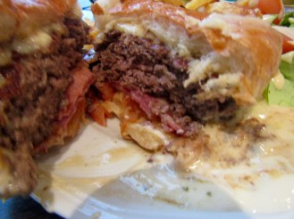 TWO types of cheese - one a creamy blue cheese topped this burger, beneath the burger is ham and tomatoes!!!!!!