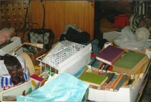 disorganized boxes in a dark basement