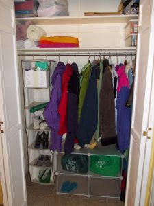 organized coat closet with shoes in a hanging rack