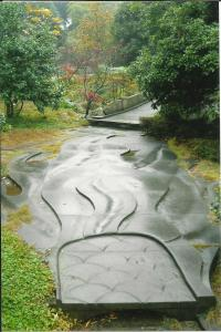 winding path with carved wavy lines and signs of recent rainfall