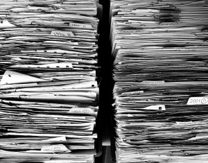 two tall stacks of paperwork and files