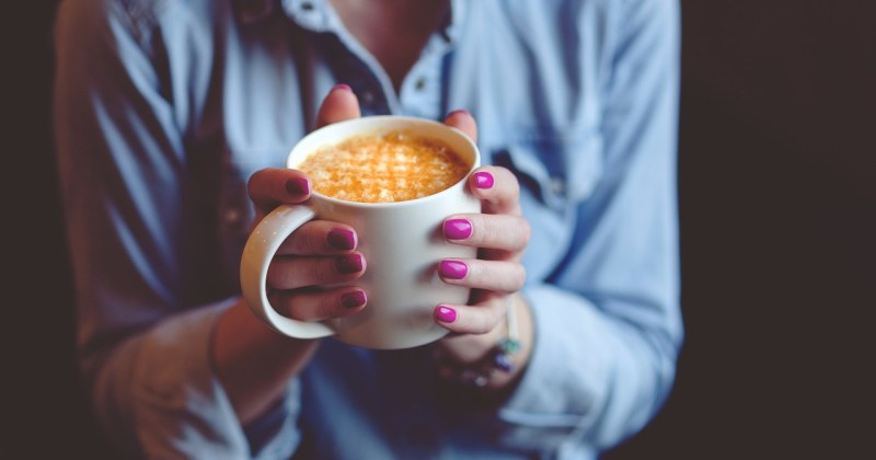 relaxed woman holding coffee cup