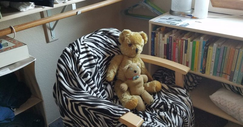 armchair with blanket and two teddy bears