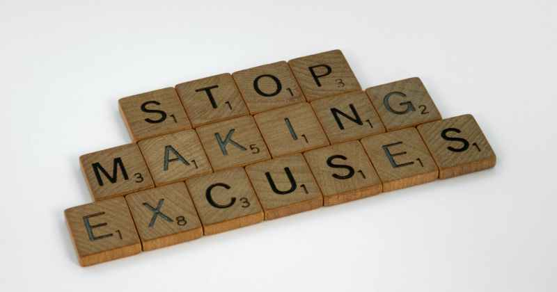 wood tiles lettered with stop making excuses