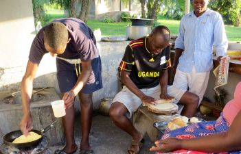 Kitchen staff making chapati.