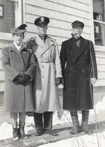 Leora (wearing Dale's wings), Dale, and Clabe Wilson. Feb. 16, 1943, Minburn, Iowa. Dale's only furlough home.